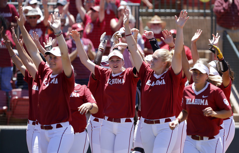 Photo -  Oklahoma celebrates a home run in the first inning during the NCAA Norman Regional at Marita Hynes Field in Norman on Sunday. [Photo by Sarah Phipps, The Oklahoman]