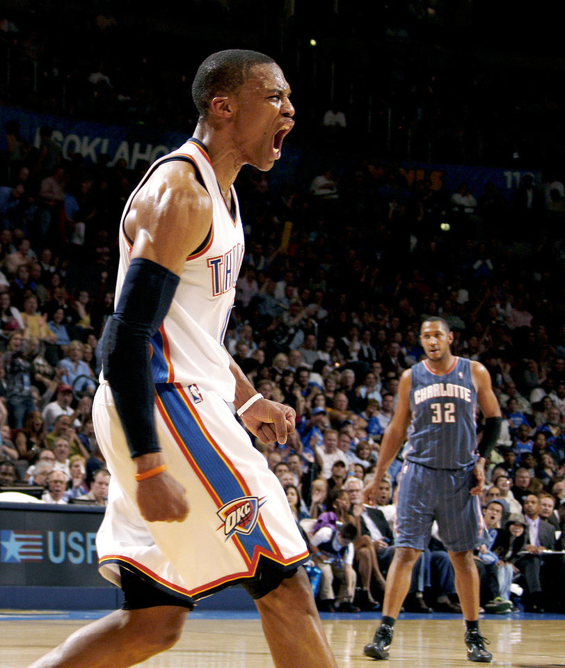 Photo - Oklahoma City's Russell Westbrook (0) reacts as Charlotte's Boris Diaw (32) watches during an NBA basketball game between the Oklahoma City Thunder and the Charlotte Bobcats at the Oklahoma City Arena, Friday, March 18, 2011. Photo by Bryan Terry, The Oklahoman