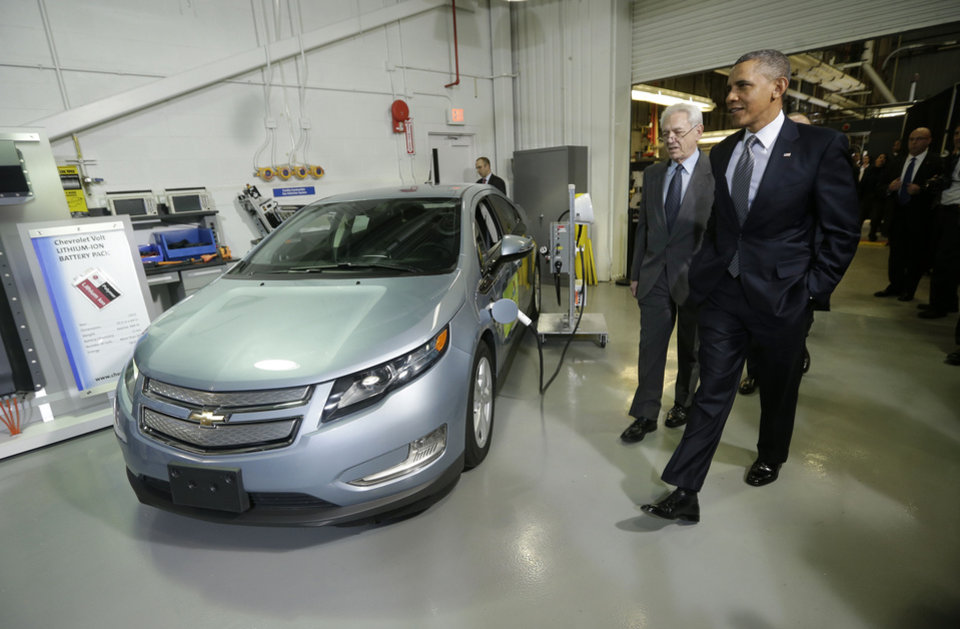 Photo - President Barack Obama and Joint Center for Energy Storage Research Director Dr. George Crabtree walk past a hybrid Chevy Volt vehicle used for testing during the president's tour of the Argonne National Laboratory in Argonne, Ill., Friday, March 15, 2013. Argonne is the first US science and engineering research national laboratory, and it remains on of the nation's largest. (AP Photo/Pablo Martinez Monsivais)