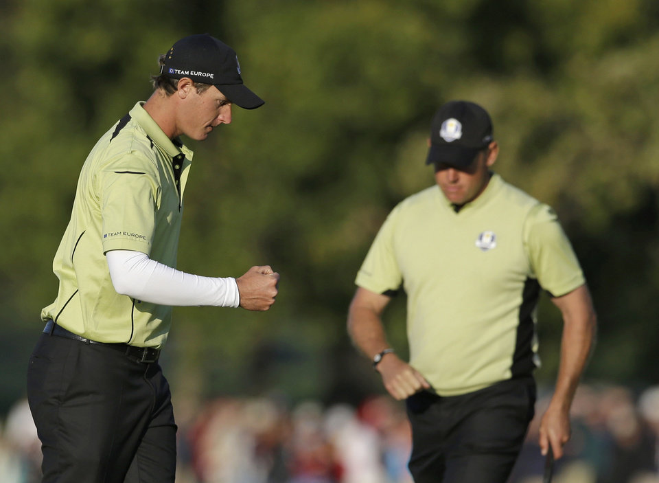 Photo -   Europe's Nicolas Colsaerts reacts after making a birdie on the 15th hole during a four-ball match at the Ryder Cup PGA golf tournament Friday, Sept. 28, 2012, at the Medinah Country Club in Medinah, Ill. (AP Photo/Chris Carlson)