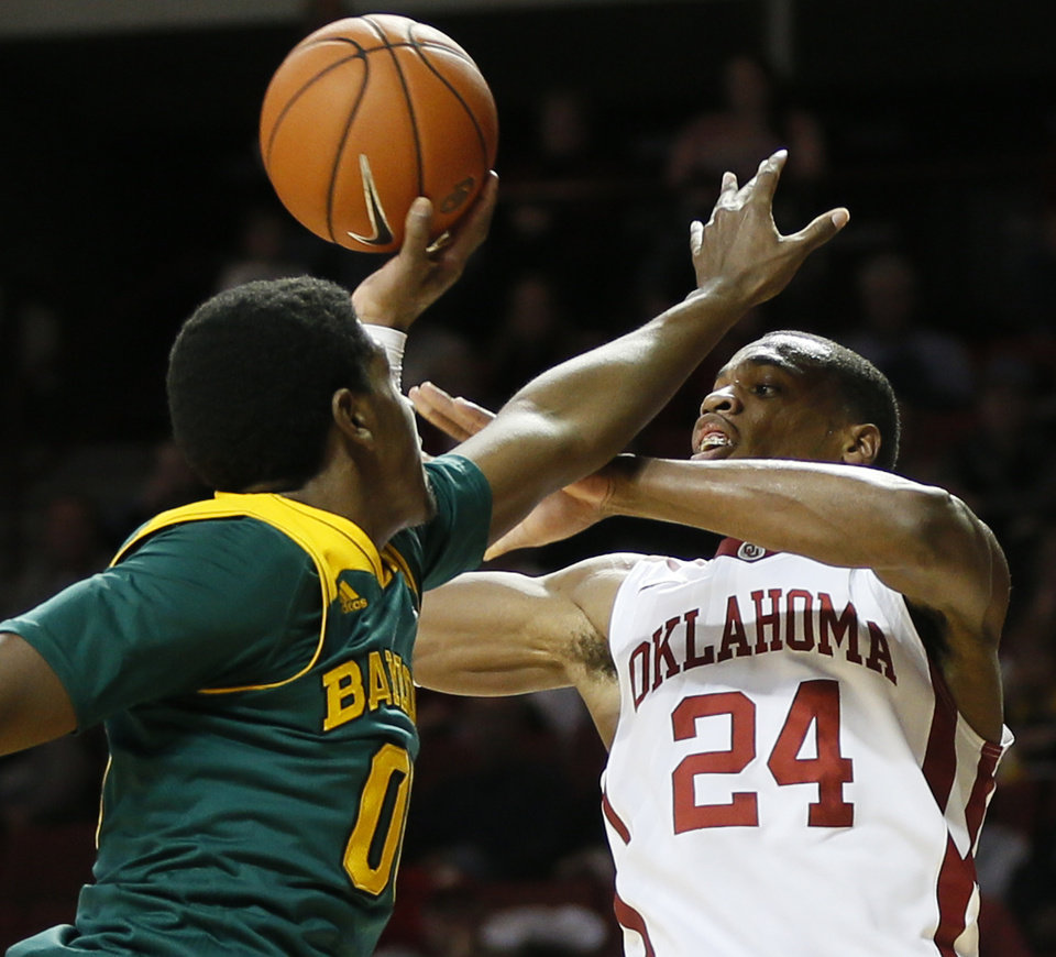 Photo - Oklahoma's Buddy Hield (24) passes the ball away from Baylor's Royce O'Neale (00) during an NCAA men's college basketball game between Baylor and the University of Oklahoma at Lloyd Noble Center in Norman, Okla., Saturday, Feb. 8, 2014. OU won, 88-72. Photo by Nate Billings, The Oklahoman