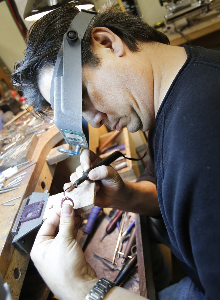 Photo - Jeweler Tim Sarr works on a wax mold for a custom ring at Naifeh Fine Jewelry. Photos By Steve Gooch, The Oklahoman