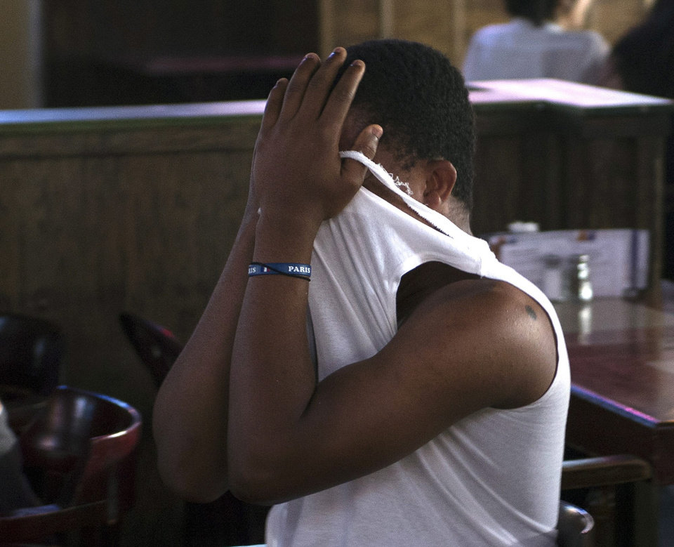 Photo - A Brazilian fan reacts after the fifth German goal during the Germany-Brazil World Cup soccer semi-final at PJ's Pub Tuesday, July 8, 2014 in Montreal.(AP Photo/The Canadian Press, Ryan Remiorz)
