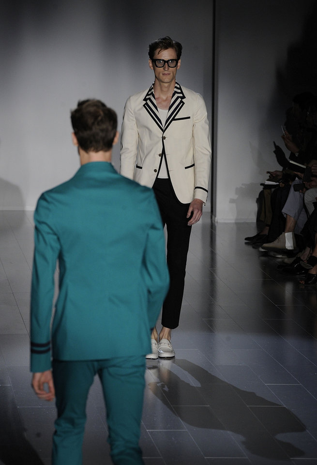 Photo - A model wears a creation for Gucci men's Spring-Summer 2015 collection, part of the Milan Fashion Week, unveiled in Milan, Italy, Monday, June 23, 2014. (AP Photo/Giuseppe Aresu)
