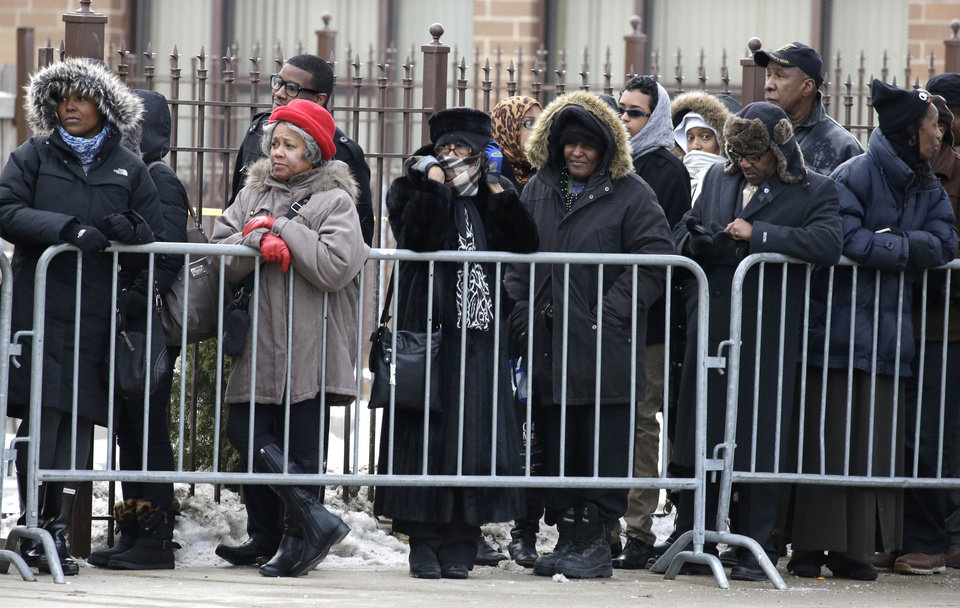 Mourners wait outside the Greater Harvest Missionary Baptist Church for the funeral service of Hadiya Pendleton Saturday, Feb. 9, 2013, in Chicago. The shooting death of the 15-year-old honor student has drawn attention to the staggering gun violence in the nation\'s third-largest city. (AP Photo/Nam Y. Huh)