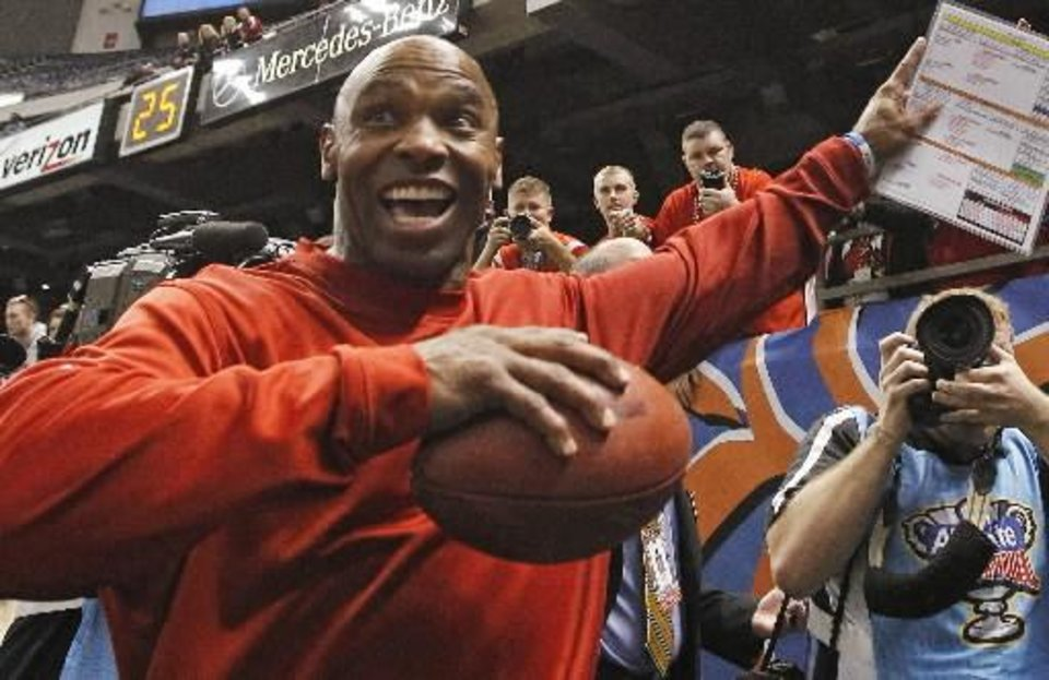 Louisville head coach Charlie Strong celebrates following a 33-23 win over Florida in the Sugar Bowl NCAA college football game Wednesday, Jan. 2, 2013, in New Orleans. (AP Photo/Butch Dill)