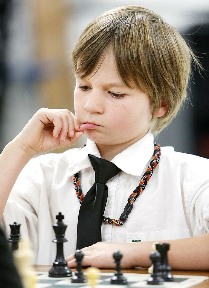 Ashton Pavao, 3rd grade, studies his chess move during a chess club meeting at Freeman Elementary School in Edmond, Tuesday December 12, 2012. Photo By Steve Gooch, The Oklahoman