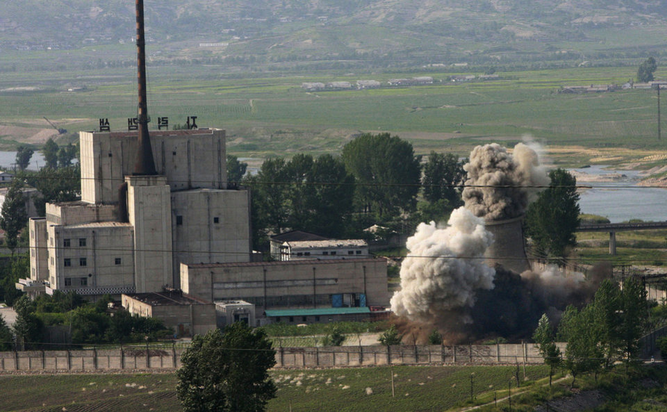 Photo - FILE - In this June 27, 2008 file photo released by China's Xinhua News Agency, the cooling tower of the Yongbyon nuclear complex is demolished in Nyongbyon, also known as Yongbyon, North Korea, in a sign of its commitment to stop making plutonium for atomic bombs. The North's plutonium reactor began operations in 1986 but was shut down as part of international nuclear disarmament talks in 2007 that have since stalled. North Korea vowed Tuesday, April 2, 2013, to restart a nuclear reactor that can make one bomb's worth of plutonium a year, escalating tensions already raised by near daily warlike threats against the United States and South Korea. (AP Photo/Xinhua, Gao Haorong, File)  NO SALES