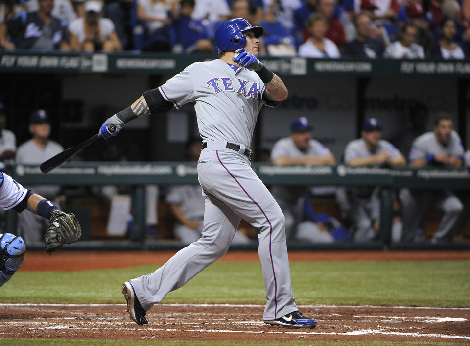 Texas Rangers' Josh Hamilton follows through on a two-run home run off Tampa Bay Rays starting pitcher Chris Archer during the fourth inning of a baseball game Saturday, Sept. 8, 2012, in St. Petersburg, Fla. (AP Photo/Brian Blanco)