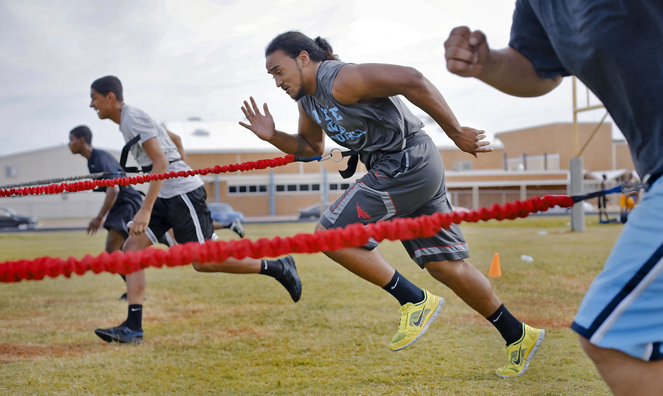 SUPER 30 / HIGH SCHOOL FOOTBALL PLAYER: Lawton Eisenhower High School's Michael Moana goes through summer football workouts at the school on Tuesday, June 18, 2013 in Lawton, Okla.   Photo by Chris Landsberger, The Oklahoman