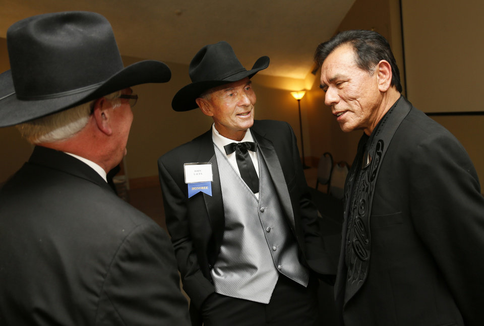 Photo - Honorees Wes Studi, right, and John Lacey, middle, talk with Chuck Schroeder during the press conference before the Western Heritage Awards at the National Cowboy & Western Heritage Museum in Oklahoma City, Saturday, April 20, 2013. Studi is being inducted into the Hall of Great Western Performers. Lacey is being inducted into the Hall of Great Westerners. Schroeder is the president of the National Cowboy & Western Heritage Museum. Photo by Nate Billings, The Oklahoman