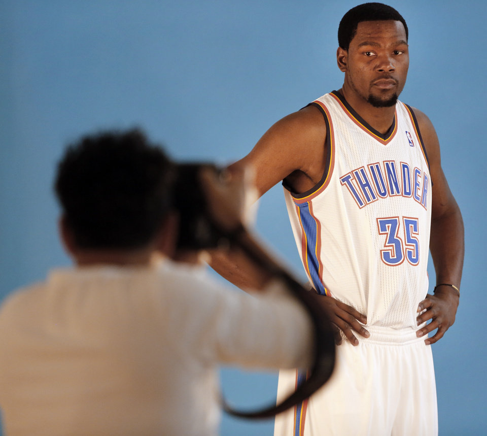 Kevin Durant poses for photos during media day with the Oklahoma City Thunder in Oklahoma City, Thursday September  27, 2013. Photo By Steve Gooch, The Oklahoman