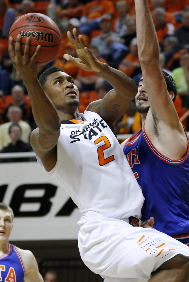 Oklahoma State\'s Le\'Bryan Nash (2) moves to the basket beside Texas-Arlington\'s Jordan Reves (55) during a college basketball game between Oklahoma State University and UT Arlington at Gallagher-Iba Arena in Stillwater, Okla., Wednesday, Dec. 19, 2012. Photo by Bryan Terry, The Oklahoman
