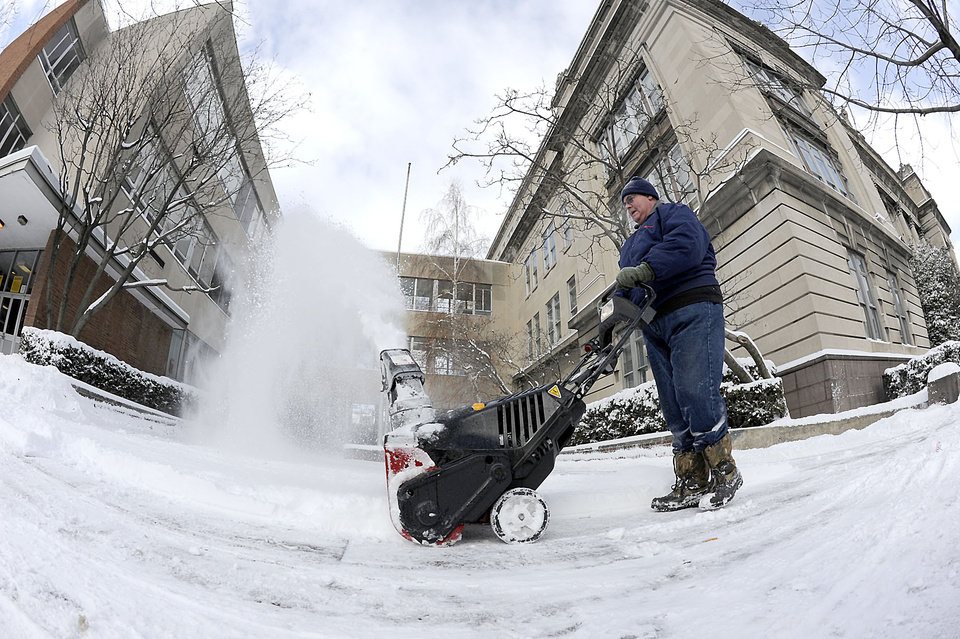 Photo - Wilkes-Barre Area School District employee Bob Nahill clears a sidewalk in front of Coughlin High School, Friday, Jan. 3, 2014 in Wilkes-Barre, Pa. Northern and eastern Pennsylvania saw 6 to 8 inches of snow, while southern and western Pennsylvania saw 2 to 5 inches, the National Weather Service said. (AP Photo/The Citizens' Voice, Mark Moran)  MANDATORY CREDIT