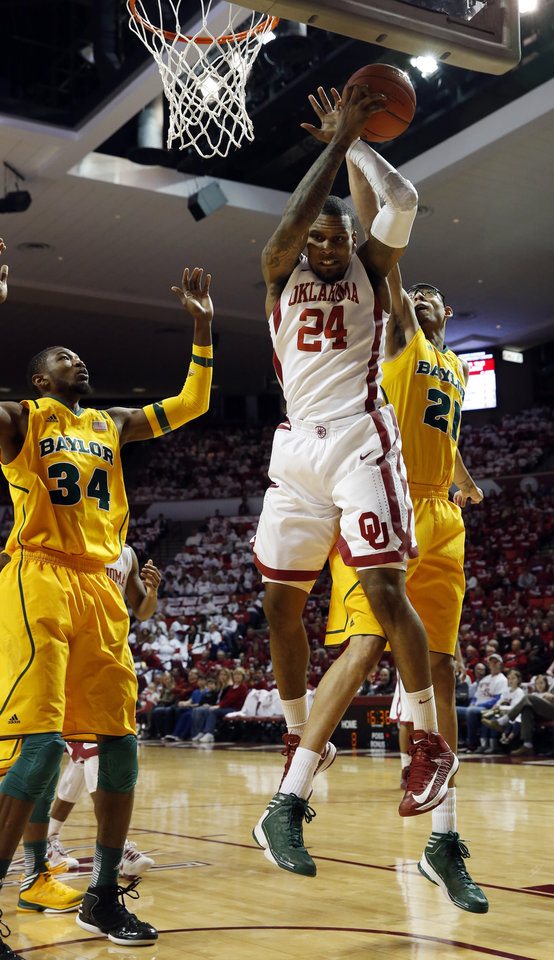 Oklahoma Sooner's Romero Osby (24) tries for an offensive rebound in front of Baylor Bear's Isaiah Austin (21) and Cory Jefferson (34) as the University of Oklahoma Sooners (OU) men play the Baylor University Bears (BU) in NCAA, college basketball at The Lloyd Noble Center on Saturday, Feb. 23, 2013  in Norman, Okla. Photo by Steve Sisney, The Oklahoman