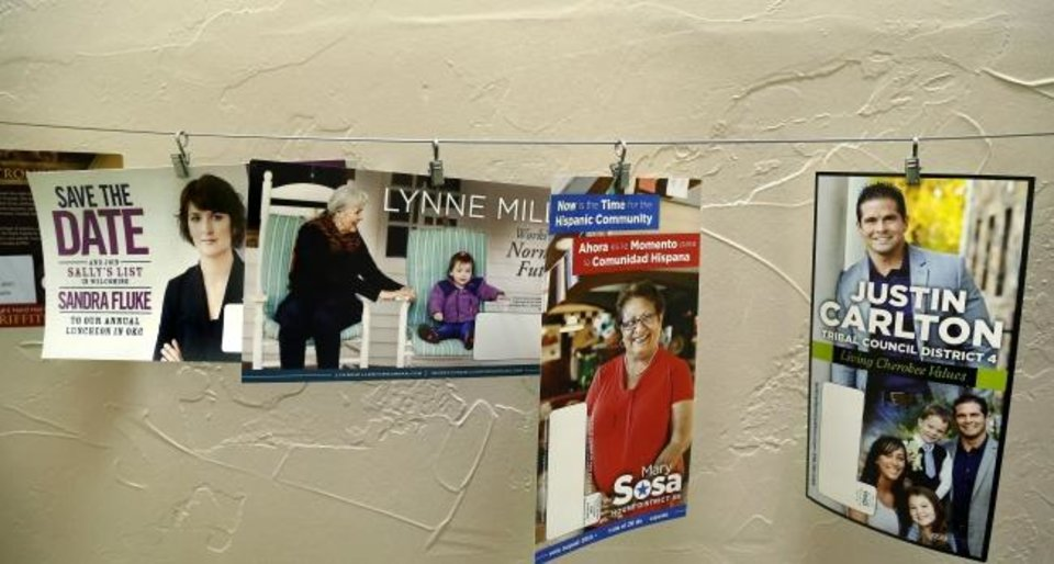 Photo -  Visitors to Skyfire Media, near NW 17 and Shartel in Oklahoma City, will walk past campaign flyers strung across a wall in a stairwell that leads to the office. [Jim Beckel/The Oklahoman]