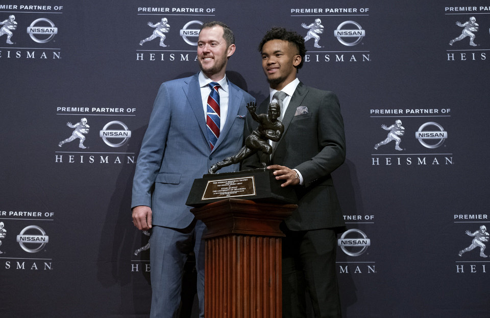 Photo - Oklahoma football coach Lincoln Riley, left, poses with Oklahoma quarterback Kyler Murray, winner of the Heisman Trophy, Saturday, Dec. 8, 2018, in New York. (AP Photo/Craig Ruttle)