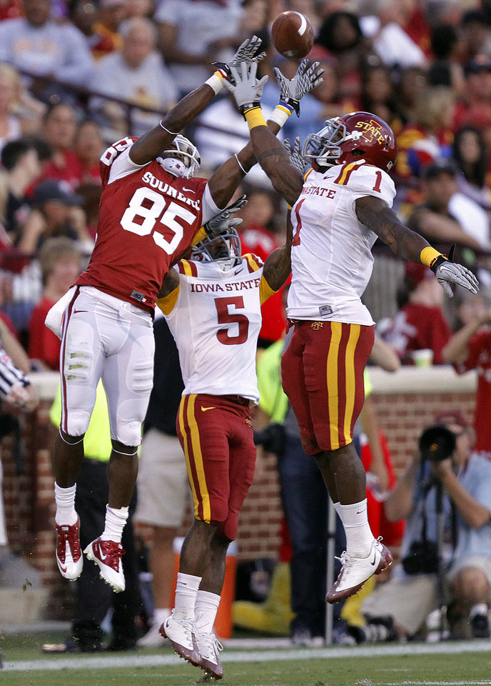 Oklahoma's Ryan Broyles (85) makes a catch over Iowa State's Jeremy Reeves (5) and David Sims (1) during the first half of the college football game between the University of Oklahoma Sooners (OU) and the Iowa State Cyclones (ISU) at the Gaylord Family-Oklahoma Memorial Stadium on Saturday, Oct. 16, 2010, in Norman, Okla.  Photo by Chris Landsberger, The Oklahoman ORG XMIT: KOD