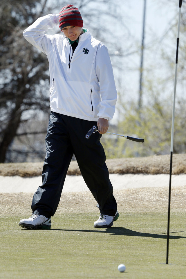 Norman North golfer Hunter Austin watches his putt during the Norman North Invitational Golf Tournament at the Jimmie Austin Golf Club on Tuesday, March 26, 2013, in Norman, Okla.   Photo by Steve Sisney, The Oklahoman
