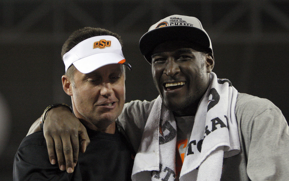 Oklahoma State head coach Mike Gundy and Justin Blackmon celebrate the Fiesta Bowl between the Oklahoma State University Cowboys (OSU) and the Stanford Cardinal at the University of Phoenix Stadium in Glendale, Ariz., Tuesday, Jan. 3, 2012. Photo by Sarah Phipps, The Oklahoman
