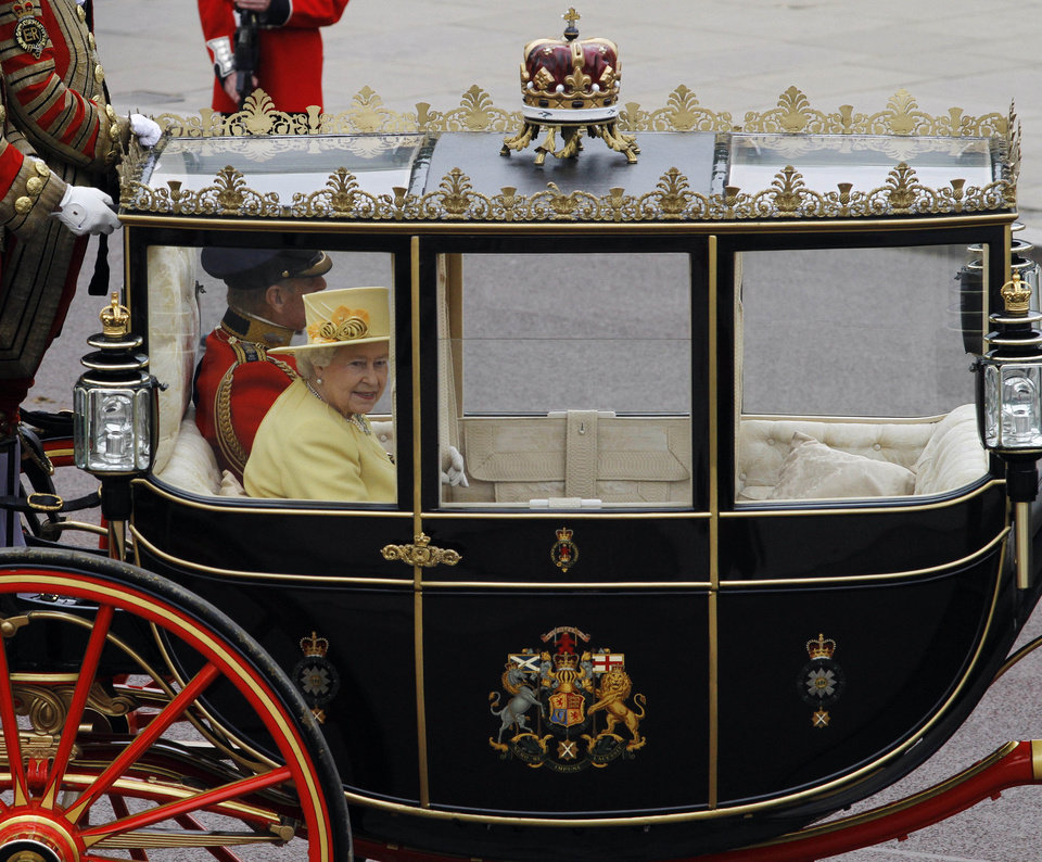 Photo - Britain's Queen Elizabeth II rides in a carriage with Britain's Prince Philip on their way to Buckingham Palace after the Royal Wedding of Britain's Prince William and his wife Kate, Duchess of Cambridge in London Friday, April, 29, 2011. (AP Photo/Matt Dunham) ORG XMIT: RWMG162
