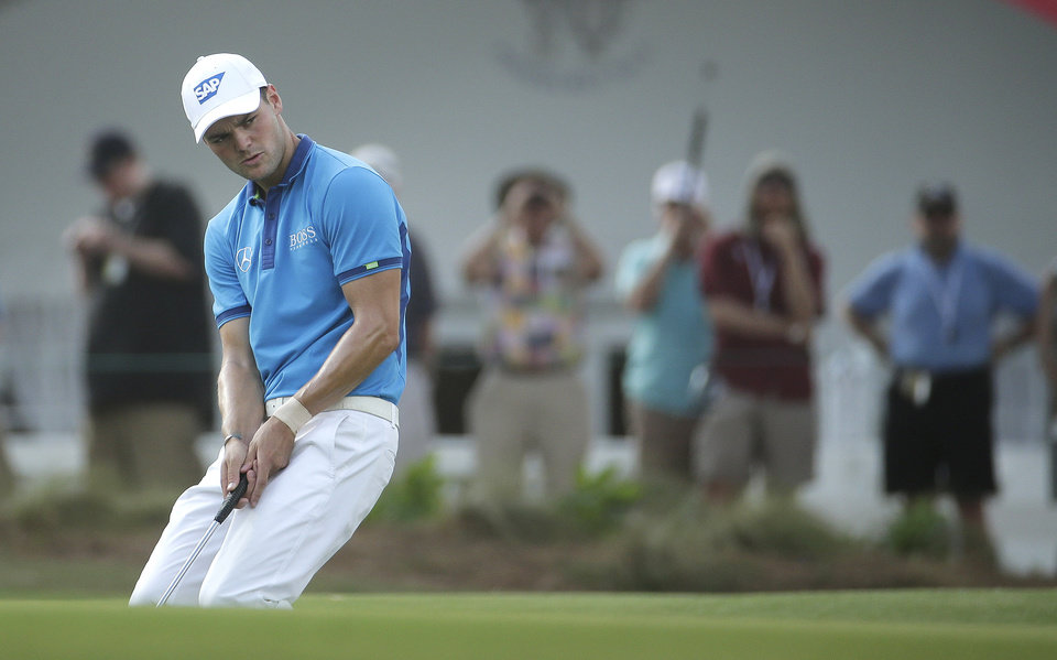 Photo - Martin Kaymer, of Germany, reacts after missing a birdie on the 13th hole during the first round of the U.S. Open golf tournament in Pinehurst, N.C., Thursday, June 12, 2014. (AP Photo/Charlie Riedel)