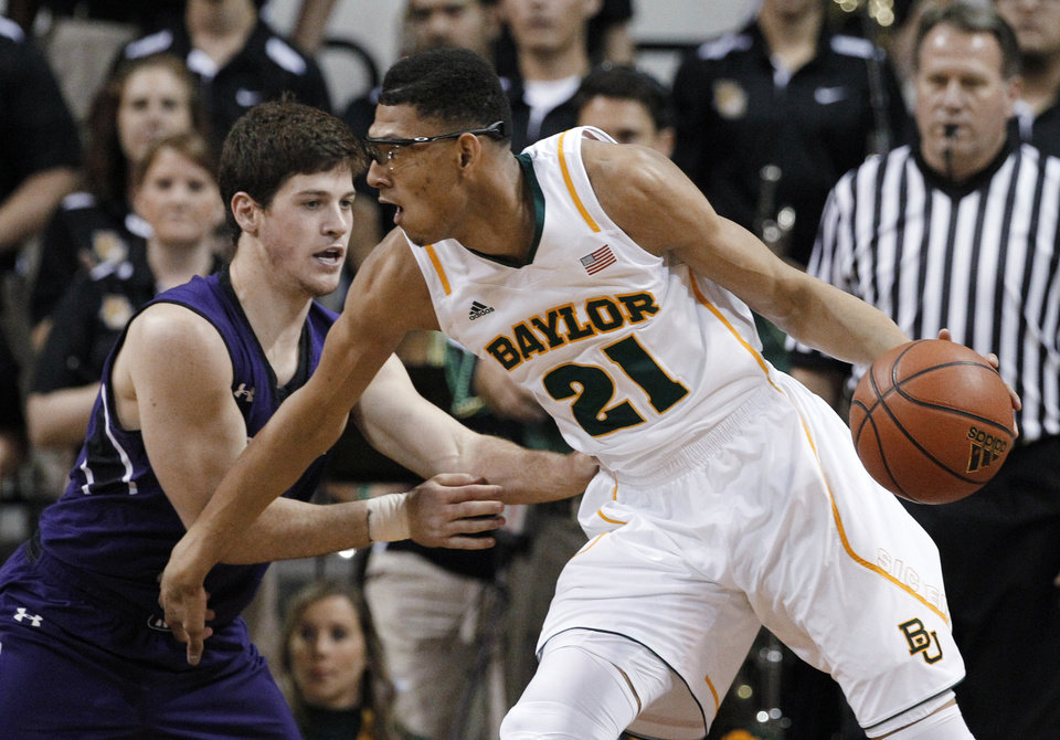 Baylor center Isaiah Austin (21) attempts to get by Northwestern's Dave Sobolewski during the first half of an NCAA college basketball game Tuesday, Dec. 4, 2012, in Waco, Texas. (AP Photo/Tony Gutierrez)