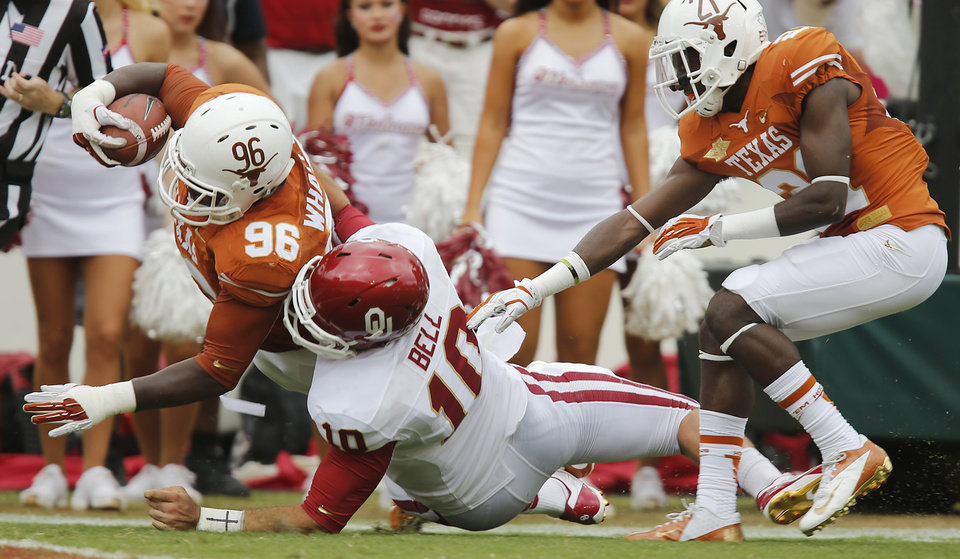 OU's Blake Bell (10) tries to stop UT's Chris Whaley (96) on an interception return for a touchdown during the Red River Rivalry college football game between the University of Oklahoma Sooners (OU) and the University of Texas Longhorns (UT) at the Cotton Bowl Stadium in Dallas, Saturday, Oct. 12, 2013. Photo by Chris Landsberger, The Oklahoman