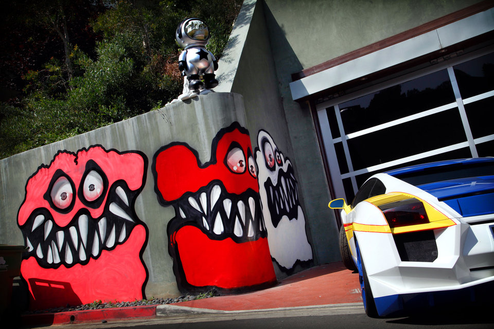 Photo - This May 10, 2013 photo shows Graffiti painted on the walls of the home of entertainer Chris Brown in Hollywood Hills, Calif.  Neighbors are angry at Brown's street art painted outside his home and local residents are calling for fines to be brought against the pop star and demanding Brown remove the street art. (AP Photo/Los Angeles Times, Barbara Davidson) NO FORNS; NO SALES; MAGS OUT; ORANGE COUNTY REGISTER OUT; LOS ANGELES DAILY NEWS OUT; VENTURA COUNTY STAR OUT; INLAND VALLEY DAILY BULLETIN OUT; MANDATORY CREDIT, TV OUT