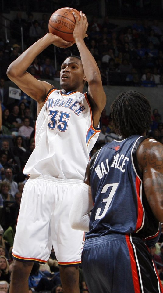 Photo - Oklahoma City's Kevin Durant (35) shoots in front of Gerald Wallace (3) of Charlotte in the second half of the NBA basketball game between the Charlotte Bobcats and the Oklahoma City Thunder at the Ford Center in Oklahoma City, Friday, April 10, 2009. Oklahoma City won, 84-81. Photo by Nate Billings, The Oklahoman ORG XMIT: KOD