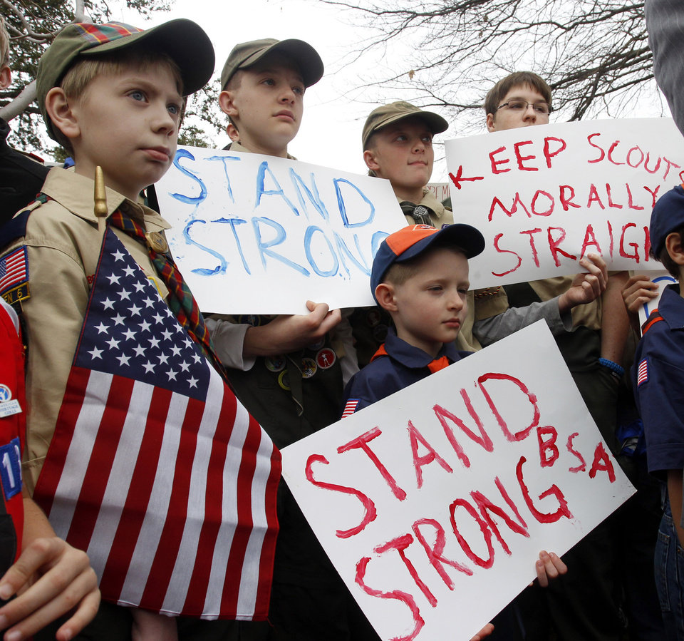 Photo - FILE - Clockwise from left,  Boy Scouts Eric Kusterer, Jacob Sorah, James Sorah, Micah Brownlee and Cub Scout John Sorah hold signs at the