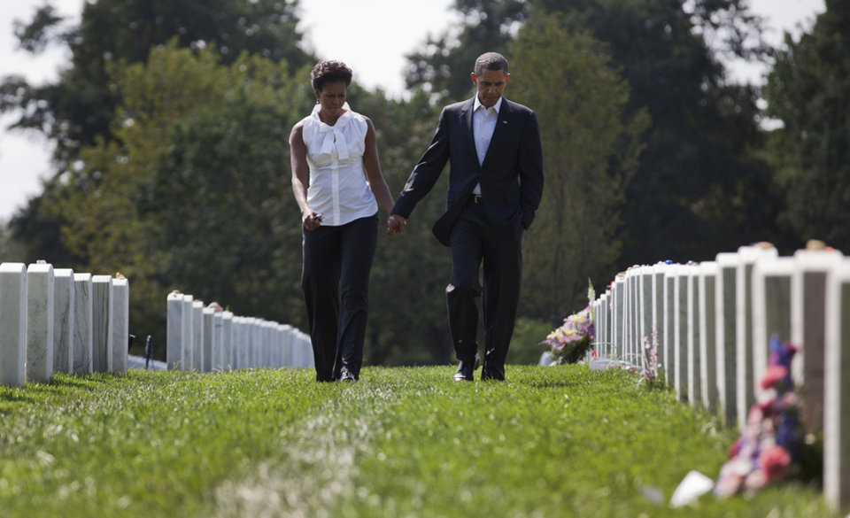 Photo -   President Barack Obama and first lady Michelle Obama visit Arlington National CemeterySaturday, Sept. 10, 2011, in Arlington, Va. Sunday will mark the 10th anniversary of the Sept. 11 attacks. (AP Photo/Carolyn Kaster)