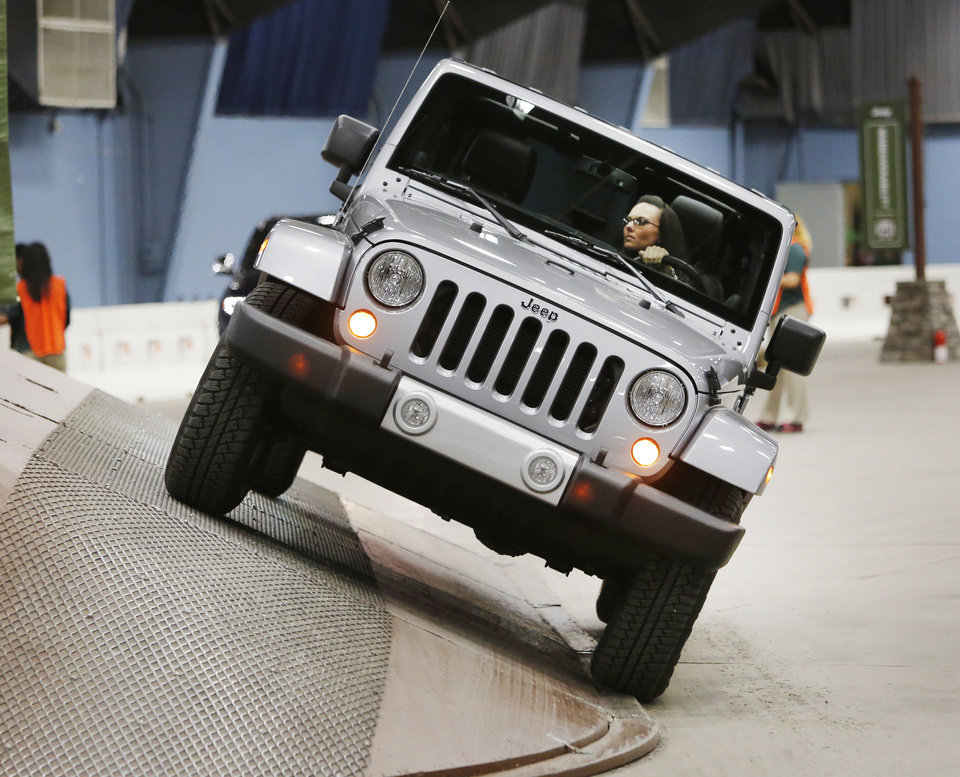 Erin O�Connor drives a Jeep Wrangler through the obstacle course of Camp Jeep at the Oklahoma City International Auto Show at State Fair Park. Photo by Steve Gooch, The Oklahoman