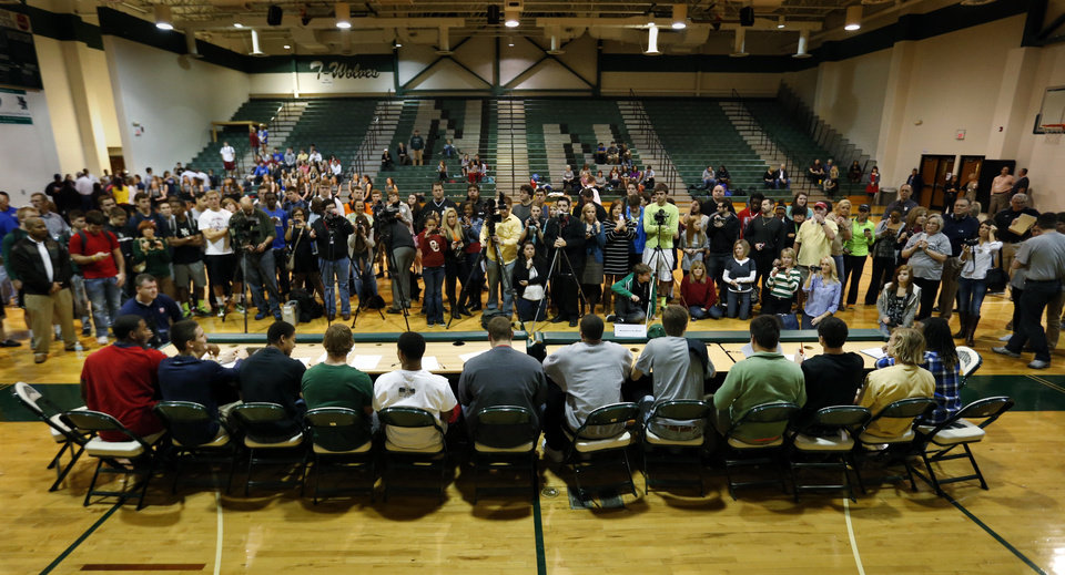 Photo - Parents, siblings, media and friends take photographs of  senior football players at a signing day assembly at Norman North High School on Wednesday, Feb. 6, 2013, in Norman, Okla.  Photo by Steve Sisney, The Oklahoman