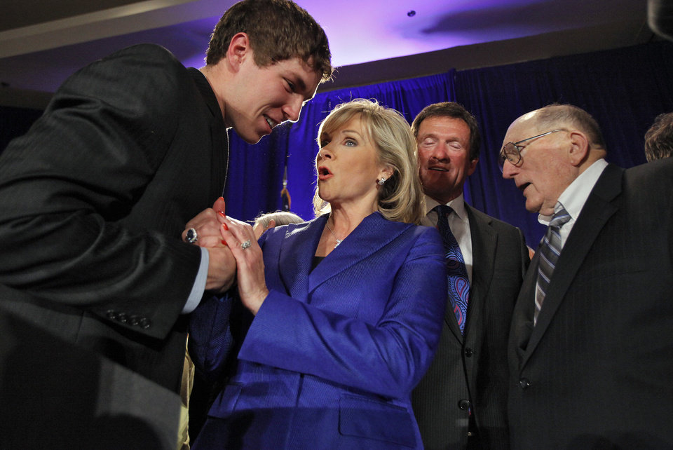 Photo - Governor elect Mary Fallin celebrates her win over Jari Askins with her son Price at the republican Watch Party at the Marriott on Tuesday, Nov. 2, 2010, in Oklahoma City, Okla.   Photo by Chris Landsberger, The Oklahoman