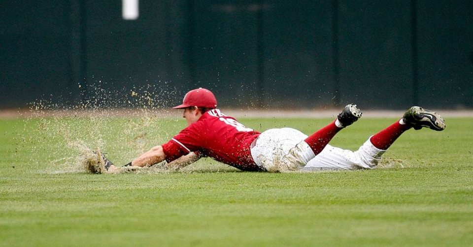 Photo -  OU right fielder Kaleb Herren (18)  makes a diving catch during the college baseball game between the University of Kansas and the University of Oklahoma at L. Dale Mitchell Park, Sunday, May 3, 2009, in Norman, Okla. Photo by Sarah Phipps, The Oklahoman