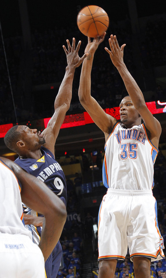 Photo - Oklahoma City's Kevin Durant (35) puts up a three point shot over Memphis' Tony Allen (9) during game one of the Western Conference semifinals between the Memphis Grizzlies and the Oklahoma City Thunder in the NBA basketball playoffs at Oklahoma City Arena in Oklahoma City, Sunday, May 1, 2011. Photo by Chris Landsberger, The Oklahoman