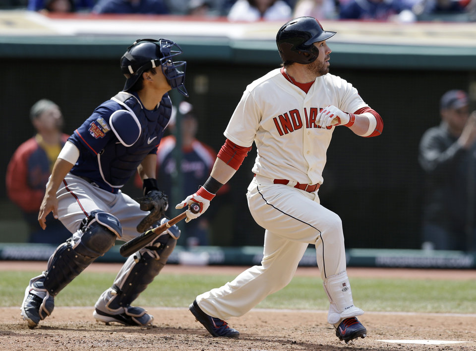Photo - Cleveland Indians' Jason Kipnis, right, watches his ball after hitting a three-run double off Minnesota Twins starting pitcher Ricky Nolasco in the fourth inning of a baseball game on Sunday, April 6, 2014, in Cleveland. Indians' Mike Aviles, Nick Swisher and Nyjer Morgan scored. Twins' catcher Kurt Suzuki, left, watches. (AP Photo/Tony Dejak)