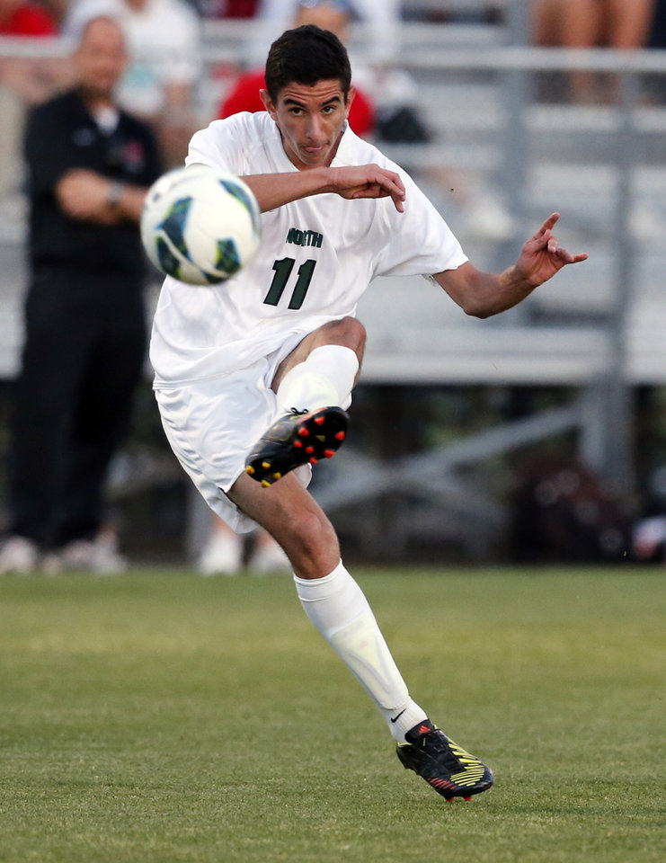 Photo - Norman North soccer player Mauro Cichero shoots against Yukon in a playoff game on Tuesday, April 30, 2013 in Norman, Okla.  Photo by Steve Sisney, The Oklahoman