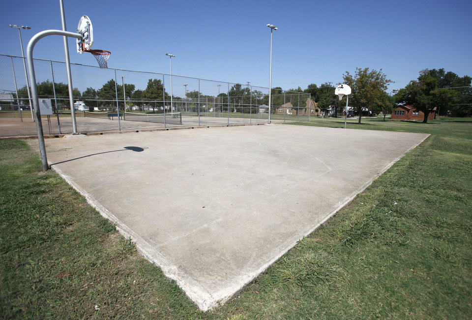 The Thunder's charity organization will pay to refurbish this basketball court at Pitts Park in northeast Oklahoma City. It's the second such court refurbishing by the team in Oklahoma City. Photo by Steve Gooch, The Oklahoman <strong>Steve Gooch</strong>