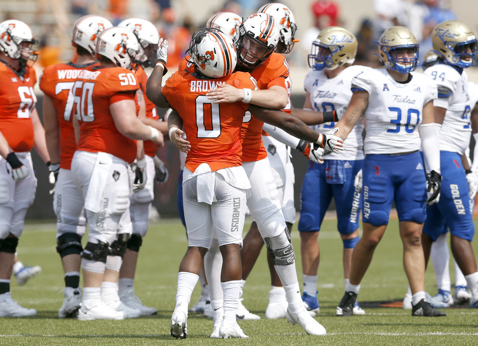 Photo - Oklahoma State's Shane Illingworth hugs teammate LD Brown after a win over Tulsa during their first game of the season at Boone Pickens Stadium in Stillwater on Saturday, September 19, 2020. JOHN CLANTON, TULSA WORLD