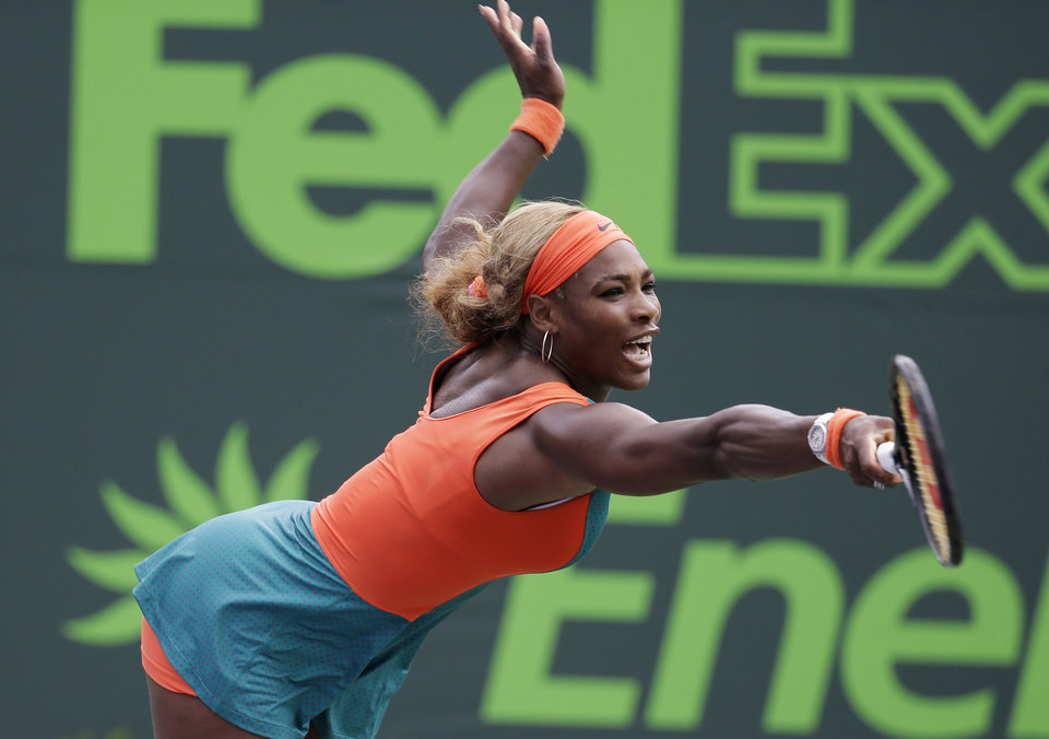 Photo - Serena Williams reaches for a serve by Coco Vandeweghe at the Sony Open tennis tournament, Monday, March 24, 2014, in Key Biscayne, Fla. (AP Photo/Lynne Sladky)