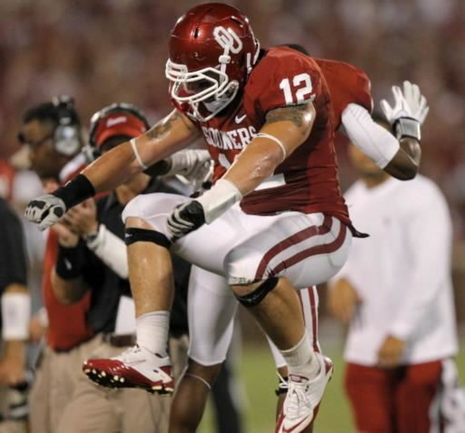 Photo - Oklahoma's Tom Wort (12) celebrates after a turnover during the college football game between the University of Oklahoma Sooners ( OU) and the Tulsa University Hurricanes (TU) at the Gaylord Family-Memorial Stadium on Saturday, Sept. 3, 2011, in Norman, Okla. Photo by Bryan Terry, The Oklahoman ORG XMIT: KOD
