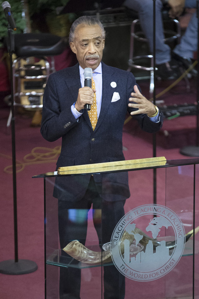 Photo - The Rev. Al Sharpton speaks during Sunday services at the Bethel Gospel Assembly as the congregation mourns the deaths of two members in Wednesday's explosions in the East Harlem neighborhood of New York, Sunday, March 16, 2014. New York City Mayor Bill de Blasio said the women lost