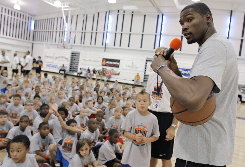 Photo - Kevin Durant answers questions from children during the second day of the Kevin Durant basketball camp at Heritage Hall in Oklahoma City, Thursday, June 30, 2011.  Photo by Garett Fisbeck, The Oklahoman