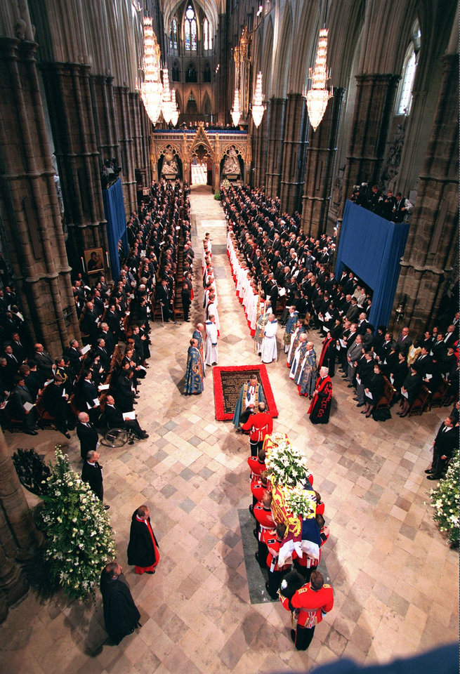 Photo - FILE - This Sept. 6, 1997 file photo shows the casket containing the body of Diana, Princess of Wales, as it is carried into Westminster Abbey by soldiers of the Welsh Guards, during funeral ceremonies in London. Sony Electronics and the Nielsen television research company collaborated on a survey ranking TV's most memorable moments. Other TV events include, the Sept. 11 attacks in 2001, Hurricane Katrina in 2005, the O.J. Simpson murder trial verdict in 1995 and the death of Osama bin Laden in 2011. (AP Photo/Peter Dejong/POOL) ORG XMIT: NYET127