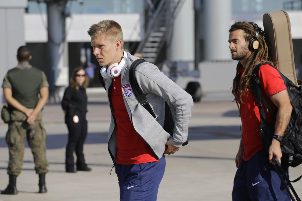 Photo - United States' national soccer team players Aron Johannsson, left, and Kyle Beckerman arrives at the Sao Paulo International airport in Brazil, Monday, June 9, 2014. The U.S. team arrived in Sao Paulo to continue their preparations for the upcoming Brazil 2014 World Cup, which starts on June 12. (AP Photo/Nelson Antoine)
