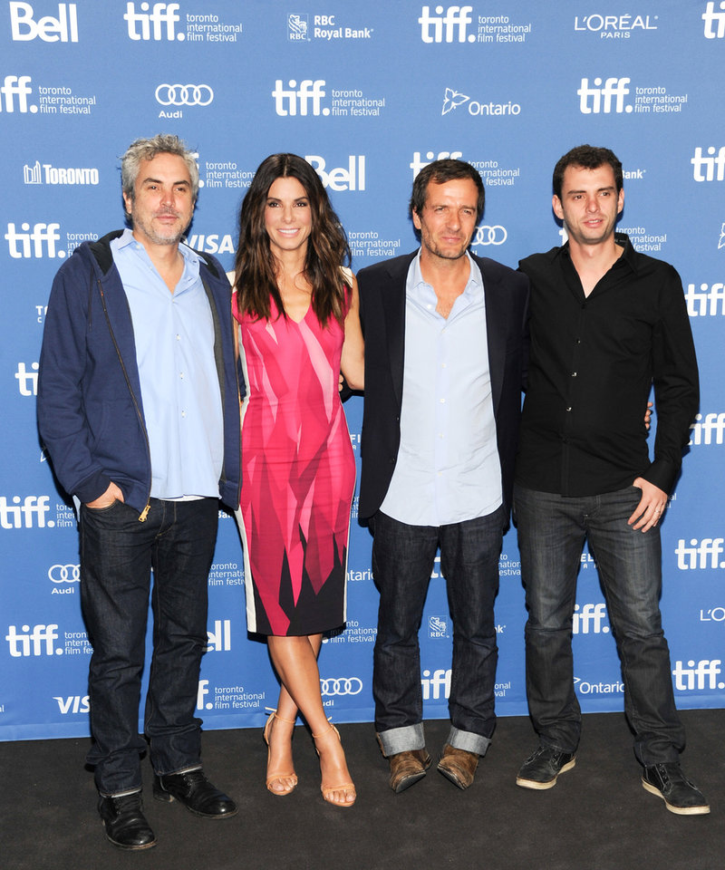 "Director Alfonso Cuaron, from left, actress Sandra Bullock, producer David Heyman and screenwriter Jonas Cuaron attend the press conference for ""Gravity"" on day 5 of the 2013 Toronto International Film Festival at the TIFF Bell Lightbox on Monday, Sept. 9, 2013 in Toronto. (Photo by Evan Agostini/Invision/AP) ORG XMIT: TOEA104"