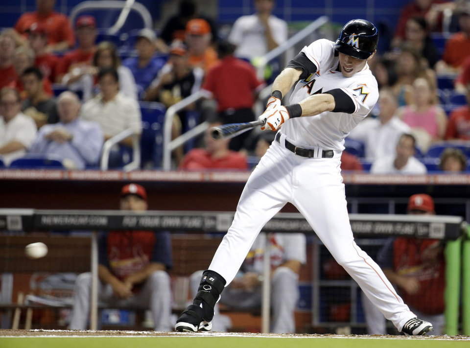 Photo - Miami Marlins' Christian Yelich hits a single in the first inning during a baseball game against the St. Louis Cardinals, Tuesday, Aug. 12, 2014, in Miami. (AP Photo/Lynne Sladky)