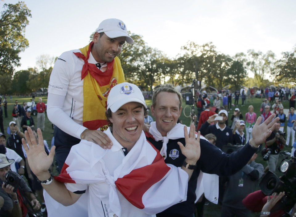 Europe's Sergio Garcia, Rory McIlroy and Luke Donald celebrate after winning the Ryder Cup PGA golf tournament Sunday, Sept. 30, 2012, at the Medinah Country Club in Medinah, Ill. (AP Photo/Charlie Riedel)  ORG XMIT: PGA242